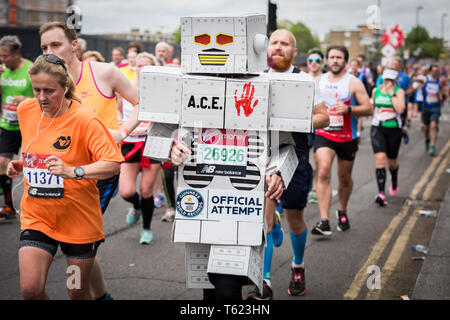 London, UK. 28th April, 2019. 39th London Marathon passes through Deptford's Evelyn Street in South East London, also the 8 mile mark of the 26.2 mile course where runners are greeted and cheered on by local residents. Credit: Guy Corbishley/Alamy Live News - Stock Photo