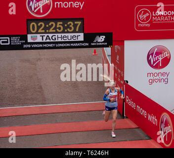 London, UK. 28th April 2019. Virgin Money London Marathon Charoltte Purdue, the first British runner to cross the line at the London marathon   2019 Credit Ian Davidson/Alamy Live News - Stock Photo