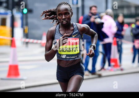 London, UK.  28 April 2019.  Runner up in the Virgin Money London Marathon elite women's race, Vivian Cheruiyot (KEN), is seen passing through mile 23. The race was won by Brigid Kosgei (KEN).  Credit: Stephen Chung / Alamy Live News - Stock Photo