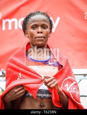 London, UK. 28th April 2019. Brigid Kosgei wins the women's race.The Mall with the finish line, Elite Men's and Women's races. The world's top runners once again assemble in for the London marathon, to contest the 39th race. Credit: Imageplotter/Alamy Live News - Stock Photo