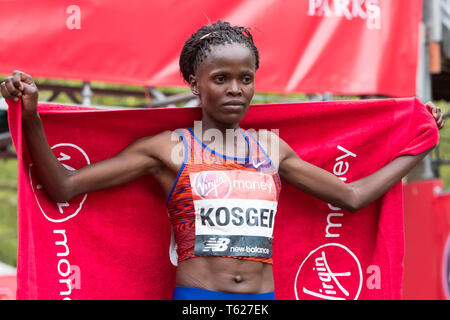 London, UK. 28th Apr, 2019. Kenya's Brigid Kosgei celebrates winning the women's London Marathon, in London, UK, April 28, 2019. Credit: Richard Washbrooke/Xinhua/Alamy Live News - Stock Photo