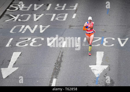 London, UK.  28 April 2019. A lone runner passes by near mile 23 in the Virgin Money London Marathon. Credit: Stephen Chung / Alamy Live News - Stock Photo