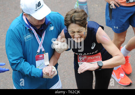 London, UK, 28 April 2019 Runners at finishing line of  Virgin London Marathon Credit: JOHNNY ARMSTEAD/Alamy Live News - Stock Photo