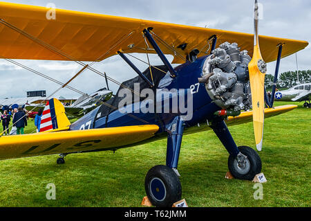 A 1943 Boeing Stearman B75 on static display at Goodwood Revival 2017 - Stock Photo