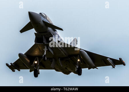 RAF Eurofighter Typhoon on approach with undercarriage down. - Stock Photo