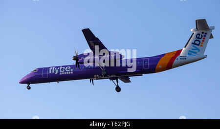 Flybe de-Haviland Canada DHC 8 Dash 8 G-PRPM coming into land at London Heathrow Airport LHR - Stock Photo