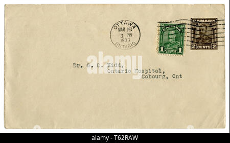 Canadian historical envelope: cover with brown imprinted stamp, two cents and green stamp one cent, George V profile, king of  Great Britain, 1933 - Stock Photo