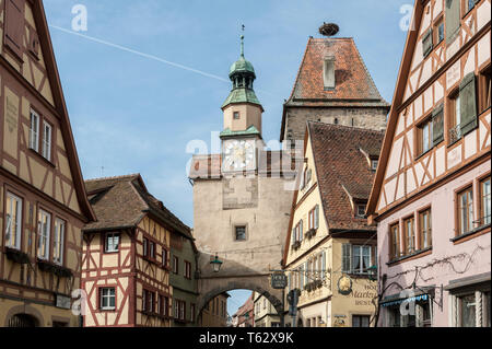 Markus Tower (Markusturm) and traditional German houses on the Rodergasse street, Rothenburg ob der Tauber, Germany - Stock Photo