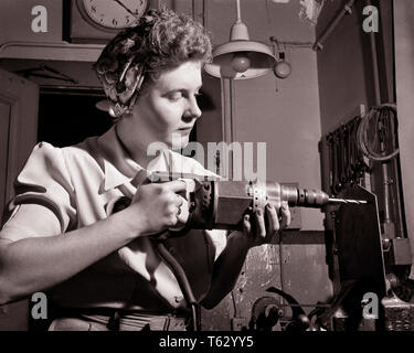 1940s PATRIOTIC ANONYMOUS UNIDENTIFIED WOMAN HOME FRONT INDUSTRIAL WORKER USING ELECTRICAL HAND DRILL DURING WORLD WAR II - q43367 CPC001 HARS FEMALES WW2 JOBS HALF-LENGTH LADIES PERSONS INSPIRATION CONFIDENCE B&W GOALS SUCCESS SKILL OCCUPATION SKILLS HOME FRONT STRENGTH VICTORY COURAGE CHOICE KNOWLEDGE LOW ANGLE POWERFUL WORLD WARS LABOR PRIDE WORLD WAR WORLD WAR TWO WORLD WAR II AUTHORITY EMPLOYMENT OCCUPATIONS UNIDENTIFIED USING CONCEPTUAL PATRIOTIC ROSIE THE RIVETER STYLISH WORLD WAR 2 ANONYMOUS EMPLOYEE PRECISION YOUNG ADULT WOMAN BLACK AND WHITE CAUCASIAN ETHNICITY DURING LABORING