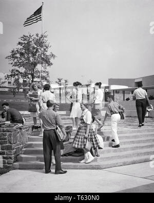1960s 1950s TEENAGE STUDENTS ON STEPS OUTSIDE A   HIGH SCHOOL BUILDING - s8778 HAR001 HARS ARCHITECTURE FEMALES HEALTHINESS COPY SPACE FRIENDSHIP FULL-LENGTH PERSONS MALES TEENAGE GIRL TEENAGE BOY BUILDINGS B&W HAPPINESS PROPERTY STYLES NETWORKING EXCITEMENT EXTERIOR HIGH SCHOOL HIGH SCHOOLS REAL ESTATE CONNECTION STRUCTURES STYLISH TEENAGED EDIFICE FASHIONS GROWTH JUVENILES TOGETHERNESS BLACK AND WHITE CAUCASIAN ETHNICITY HAR001 OLD FASHIONED - Stock Photo