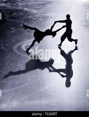1920s ANONYMOUS SILHOUETTED FIGURE SKATING COUPLE REFLECTED ON THE ICE GRINDELWALD BERNESE OBERLAND SWITZERLAND - w13 HAR001 HARS HEALTHINESS COPY SPACE FRIENDSHIP FULL-LENGTH LADIES PHYSICAL FITNESS PERSONS MALES RISK ATHLETIC CONFIDENCE B&W PARTNER HAPPINESS HIGH ANGLE STRENGTH SWITZERLAND COURAGE RECREATION ON THE CONNECTION CONCEPTUAL STYLISH BERNESE ANONYMOUS ICE SKATING MID-ADULT MID-ADULT MAN MID-ADULT WOMAN REFLECTED RELAXATION TOGETHERNESS WIVES BLACK AND WHITE CAUCASIAN ETHNICITY HAR001 OLD FASHIONED - Stock Photo