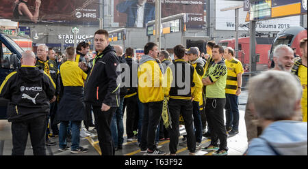 CENTRAL STATIONS, MUNICH, APRIL 6, 2019: bvb fans drinking alcohol at the central station - Stock Photo