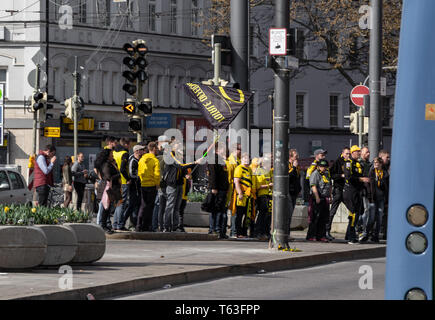 CENTRAL STATIONS, MUNICH, APRIL 6, 2019: bvb fans on the way to the soccer game fc bayern munich vs bvb - Stock Photo