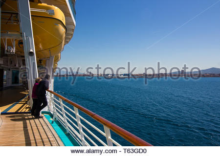 Pisa, Italy - May, 17, 2017: Cruise passengers watch on from the deck as royal caribbean navigator of the seas head to Marina di Pisa. - Stock Photo