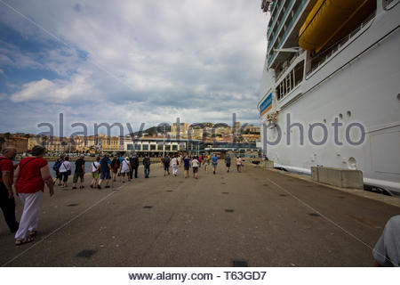 Corsica, France - May, 19, 2017: Cruise passengers making their way from royal caribbean ship to Corsica city. - Stock Photo