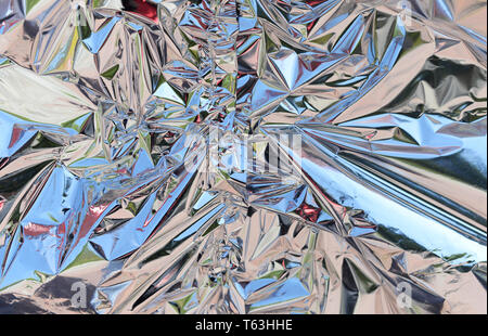 foil material background glitters in the sun - Stock Photo