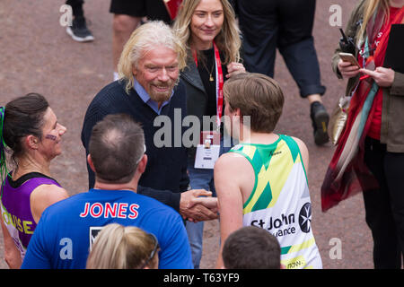 Sir Richard Branson at finish of the 2019 Virgin Money London Marathon, over 40,000 runners took part in the marathon in London this weekend. - Stock Photo