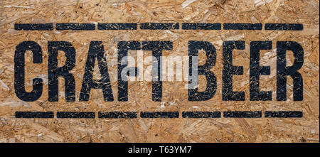 A Rustic Sign For Craft Beer Outside A Pub Or Bar Or Restaurant - Stock Photo