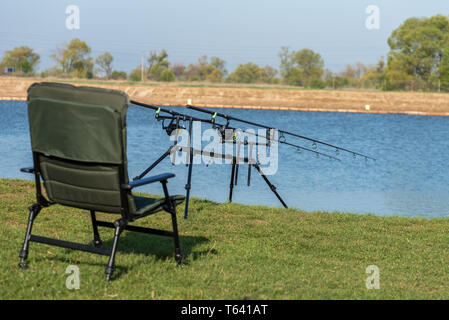 Fishing adventures, carp fishing. Is fishing with carpfishing technique. Camping on the shore of the lake. - Stock Photo