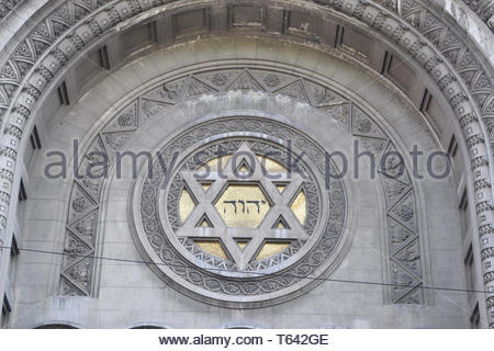 the tetragrammaton YHWH combined with the star of David, at the front of a synagogue in Buenos Aires, Argentina - Stock Photo