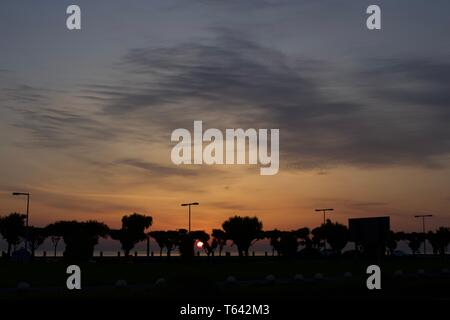 sunrise view by the beach of kuwait city - Stock Photo