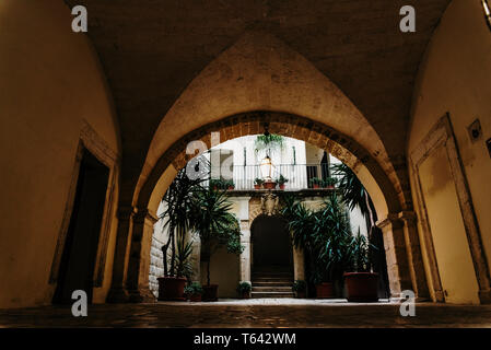 Bari, Italy - March 12, 2019: Interior atrium of a typical dwelling in Italian renancentist style. - Stock Photo