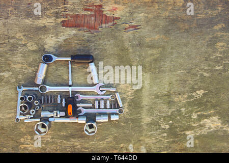 Tool to repair in form of car on wooden background. Top view. Flat lay. Toned image. - Stock Photo