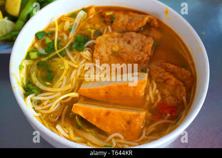Bun Cha Ca - Delicious grilled catfish fish caked noodles Da Nang signature dish Vietnamese food Asian cuisine with red green chilly herb tomato onion - Stock Photo