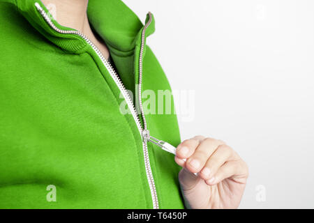 Sweatshirt design and fashion concept - young woman in green sweatshirt with zipper - Stock Photo