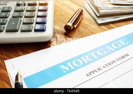 Mortgage application form, calculator and money. - Stock Photo