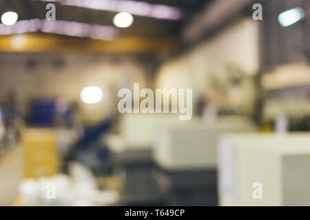 Blurred and abstract industrial factory and machinery production line background - Stock Photo