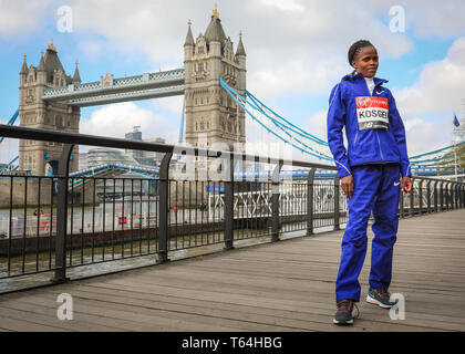 London, UK, 29th April 2019. Brigid Kosgei, Kenya. Women's race winner.The Elite Race winners of the 2019 Virgin London Marathon pose for photographers near Tower Bridge in London. Credit: Imageplotter/Alamy Live News - Stock Photo