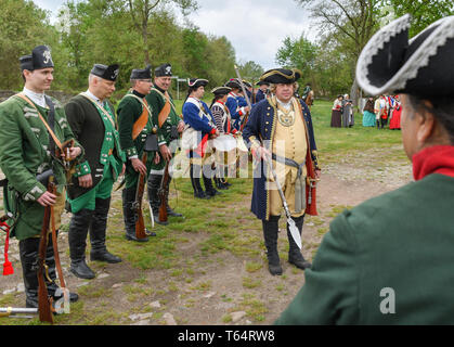 27.04.2019, Poland, Kostrzyn: Participants in historical uniforms of the interest group 'Der Dreispitz' took part in the opening rally in the Kustrin Fortress. Every year the Dreispitz clubs meet alternately in the Oderbruch in the Gossbieser Loose and in Fort Gorgast to train in historical uniform, to march and to carry out theatrical struggles. Participants created realistic insights into life in the bivouac, the old exercise regulations and warfare techniques. The Fort Gorgast in the district of Markisch-Oderland (Brandenburg), was built in 1883 as one of four parts of the fortifications of - Stock Photo