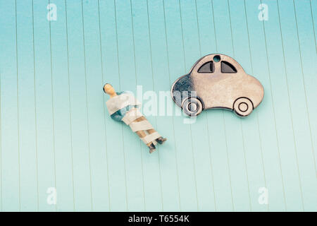 Little metal car model on lined paper background - Stock Photo