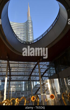 A panoramic futuristic view to the modern skyscraper tower of the Unicredit business centre at Milan Porta Nuova business centre in a sunny  day. - Stock Photo