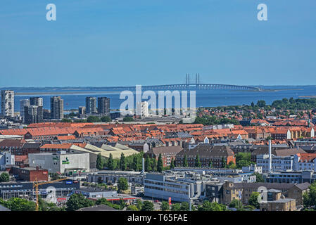 Panoramic view of Copenhagen from the top of the helix spire tower of the Church of Our Saviour and in the background Oresund Bridge crossing the Ores - Stock Photo