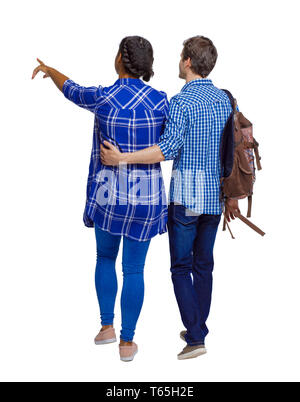 Back view of interracial going couple who points somewhere. Students on excursions. Rear view people collection. backside view of person. Isolated ove - Stock Photo