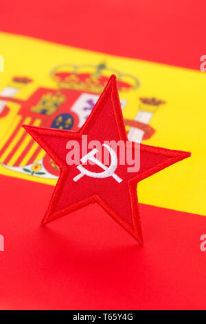 Red Star Hammer and Sickle badge with Spanish flag. Metaphor for Socialist win of 2019 Spanish general election. - Stock Photo