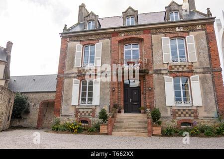 Sainte-Marie-du-Mont, France - August 16, 2018: Street view and historic old Building in Sainte Marie du Mont. Manche, Normandy, France - Stock Photo
