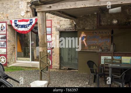 Sainte-Marie-du-Mont, France - August 16, 2018: Scenery of military souvenir shop La Boutique du Holdy in Sainte Marie du Mont. Normandy, France - Stock Photo