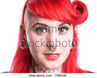 young woman with piercings and tattoos - Stock Photo