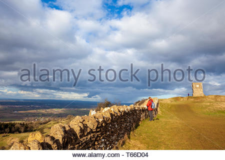A Bredon Hill dry-stone wall and Parson's Folly on top of Kemerton Camp - Stock Photo