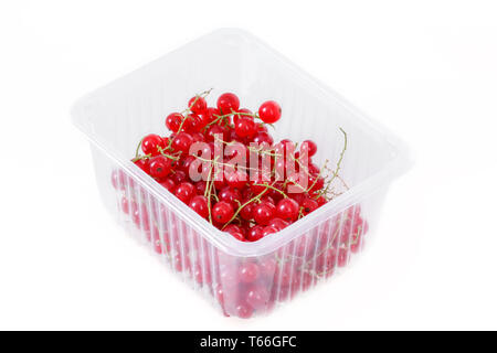 pile berries of red currant on white background - Stock Photo