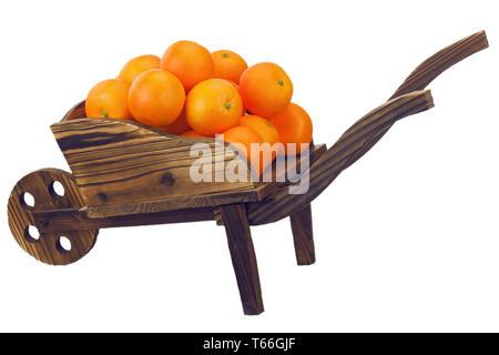 Oranges on pushcart isolated on white background. - Stock Photo