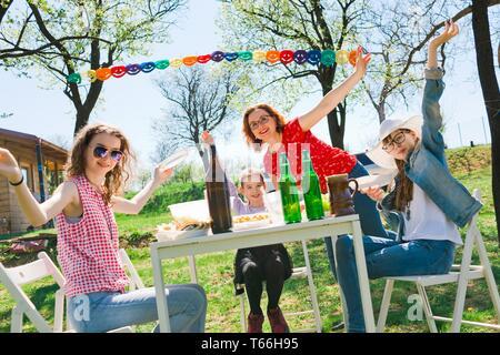 Birthday garden party during summer sunny day - backyard picnic - Stock Photo