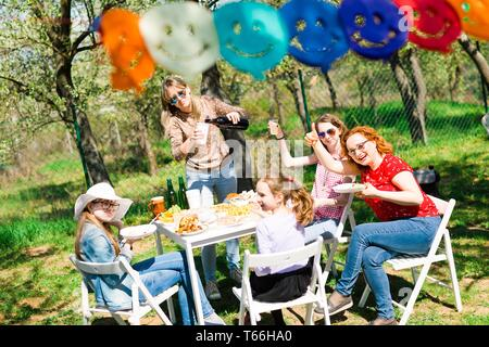 Birthday garden party during summer sunny day - preparing drinks - Stock Photo