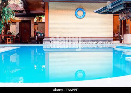 Kuta, Bali, Segara hotel, 2018-04-04: Modern tropical villa with swimming pool. Luxury summer resort. - Stock Photo