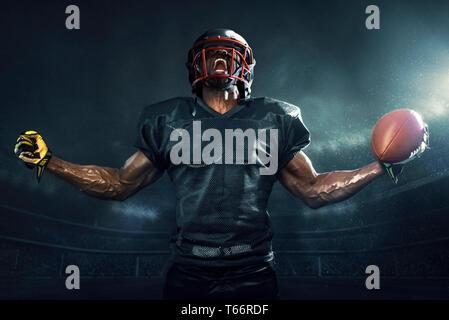 Muscular football player cheering - Stock Photo
