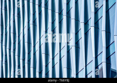 Architectural abstract, a modern office building with glass and windows in London - Stock Photo