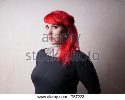 woman with tattoos and piercings - Stock Photo